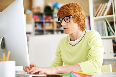 red hair men in front of a computer
